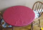 round red fitted plastic table covers