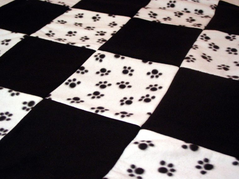 paw print tablecloth for a dog party theme | table covers depot