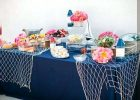extra long tablecloth food station with navy blue tablecloth and netting for nautical ocean theme baby shower beach themed plastic tablecloths