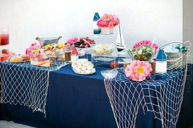 extra long tablecloth-food-station-with-navy-blue-tablecloth-and-netting-for-nautical-ocean-theme-baby-shower-beach-themed-plastic-tablecloths